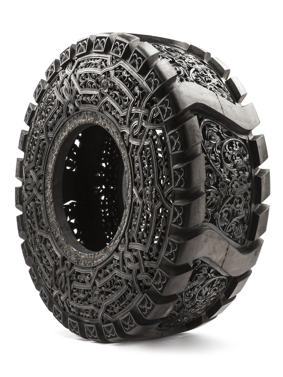 Untitled, 2010 hand carved car tyre 71 x 14 cm
